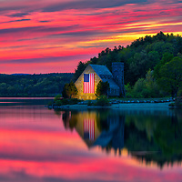 Abandoned Old Stone Church in West Boylston of Central Massachusetts on a beautiful spring evening at sunset. New England sunset colors beautifully framed this historic landmark while church and sky colors reflecting in the Wachusetts Reservoir. <br /> <br /> Massachusetts West Boylston Old Stone Church photography pictures are available as museum quality photo, canvas, acrylic, wood or metal prints. Wall art prints may be framed and matted to the individual liking and interior design decoration needs:<br /> <br /> https://juergen-roth.pixels.com/featured/this-land-was-made-for-you-and-me-juergen-roth.html<br /> <br /> Good light and happy photo making!<br /> <br /> My best,<br /> <br /> Juergen