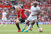 Michael Carrick All-Stars Marcos Senna tackled by Manchester United 08 XI Paul Scholes during the Michael Carrick Testimonial Match between Manchester United 2008 XI and Michael Carrick All-Star XI at Old Trafford, Manchester, England on 4 June 2017. Photo by Phil Duncan.