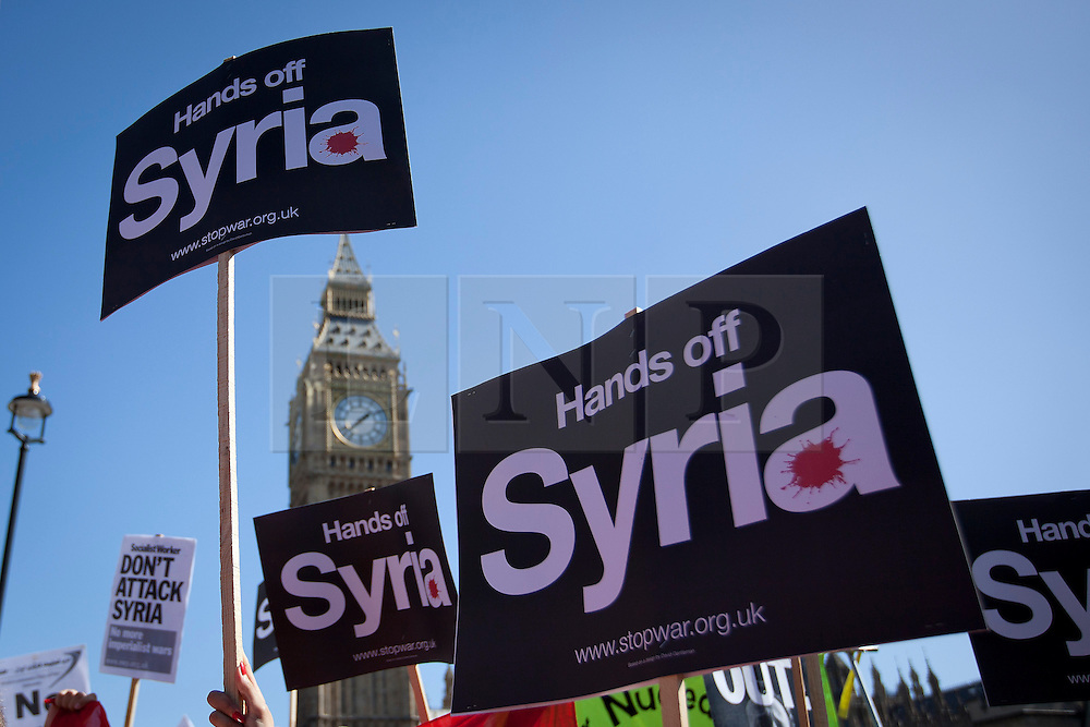 © Licensed to London News Pictures. 31/08/2013. London, UK. Stop the War Coalition protesters and supporters are seen in Whitehall, London, today (31/08/2013) taking part in a demonstration against any potential military intervention in the Syrian Civil War by western powers. Photo credit: Matt Cetti-Roberts/LNP