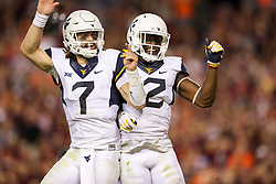 Sep 3, 2017; Landover, MD, USA; West Virginia Mountaineers wide receiver Gary Jennings (12) scores a touchdown and celebrates with West Virginia Mountaineers quarterback Will Grier (7) during the fourth quarter against the Virginia Tech Hokies at FedEx Field. Mandatory Credit: Ben Queen-USA TODAY Sports