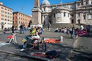 Roms 9 Aprile 2011.Manifestazione dei lavoratori precari per chiedere 'Diritti, welfare, maternità, pensione per tutti'..Tendopoli contro l'emergenza casa a piazza Esquilino
