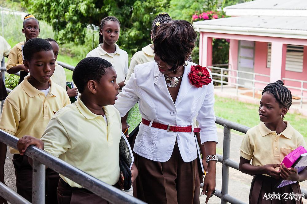 Art teacher and department chair, Ms. Linda D. Freeman, instructs her 4th grade students on the First Day of School at Joseph A. Gomez Elementary School. 4 September 2012.  © Aisha-Zakiya Boyd