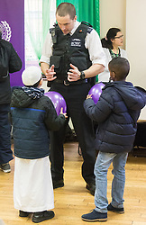 "Finsbury Park Mosque, London, February 7th 2016. Local copper Sergeant Andy Perversi explains his job to two young boys as part of a Visit My Mosque initiative by the Muslim Council of Britain to show non-Muslims ""how Muslims connect to God, connect to communities and to neighbours around them"".<br /> . ///FOR LICENCING CONTACT: paul@pauldaveycreative.co.uk TEL:+44 (0) 7966 016 296 or +44 (0) 20 8969 6875. ©2015 Paul R Davey. All rights reserved."