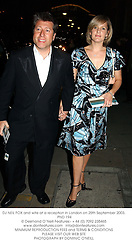 DJ NEIL FOX and wife at a reception in London on 25th September 2003.<br /> PND 194