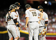 Sep. 24 2011; Phoenix, AZ, USA; San Francisco Giants pitching coach Dave Righetti talks with pitcher Eric Surkamp (47) on the mound during the first inning against the Arizona Diamondbacks at Chase Field. The Diamondbacks defeated the Giants 15-2.   Mandatory Credit: Jennifer Stewart-US PRESSWIRE..