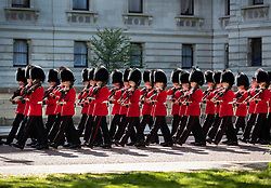 © Licensed to London News Pictures. 13/05/2019. London, UK. Guardsmen pass the back of Downing Street as they take part in rehearsals for Trooping of the Colour ceremony in bright sunshine in Horse Guards Parade. The ceremony - on June 8, 2019 - heralds the birthday of Queen Elizabeth II. Photo credit: Peter Macdiarmid/LNP