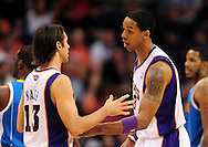 Jan. 30, 2011; Phoenix, AZ, USA; Phoenix Suns guard Steve Nash (13) talks with teammate forward Channing Frye (8) on the court against the New Orleans Hornets at the US Airways Center. The Suns defeated the Hornets 104-102.  Mandatory Credit: Jennifer Stewart-US PRESSWIRE.