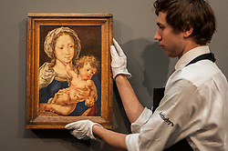 "© Licensed to London News Pictures. 04/12/2015. London, UK. A technician holds ""Mabuse"" by Jan Gossaert (est. £4-6 million), ahead of Sotheby's London evening sale of Old Master and British paintings on 9th December 2015.  Photo credit : Stephen Chung/LNP"