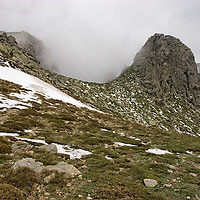 """As we were walking upwards toward """"Refuge de Prati"""" the weather became colder. In the month of june, snow coupled by fog became our companion on an altitude below 2000 meter."""
