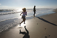Lindsey Maguire  and mom Lesley walk in the surf at Jones Beach New York , Saturday, January 06, 2006 (Andrew Gombert for The New York Times)<br />