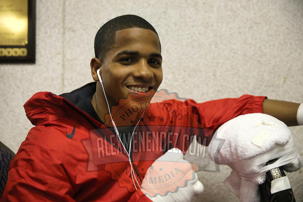 Felix Verdejo smiles in his locker room as he prepares for a fight at the Bahia Shriners Center on Saturday, April 19, 2014 in Orlando, Florida.  (AP Photo/Alex Menendez)