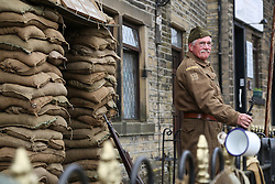 © Licensed to London News Pictures. 13/05/2016. Haworth, UK. Michael Hodgson on guard in his home guard uniform during the annual 1940's weekend in Haworth, West Yorkshire.  Photo credit : Ian Hinchliffe/LNP