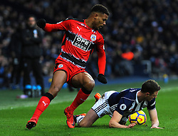 Steve Mounie of Huddersfield Town fouls Jonny Evans of West Bromwich Albion -Mandatory by-line: Nizaam Jones/JMP - 24/02/2018 - FOOTBALL - The Hawthorns - West Bromwich, England - West Bromwich Albion v Huddersfield Town- Premier League