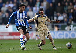 Wigan Athletic's James Perch competes with Leeds United's Alex Mowatt - Photo mandatory by-line: Richard Martin-Roberts/JMP - Mobile: 07966 386802 - 07/03/2015 - SPORT - Football - Wigan - DW Stadium - Wigan Athletic v Leeds United - Sky Bet Championship