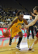 December 09 2010: Iowa guard Kachine Alexander (21) drives with the ball during the first half of their NCAA basketball game at Carver-Hawkeye Arena in Iowa City, Iowa on December 9, 2010. Iowa defeated Iowa State 62-40 in the Hy-Vee Cy-Hawk Series rivalry game.