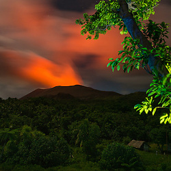 Volcan Yasur erupts in the middle of the night, seen from a distance, Tannah, Vanuatu.