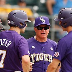 Apr 04, 2010; Baton Rouge, LA, USA; LSU Tigers coach Paul Mainieri (center) talks to players Grant Dozar (7) and Austin Nola (36) during a game against the Georgia Bulldogs at Alex Box Stadium. Mandatory Credit: Derick E. Hingle-US PRESSWIRE