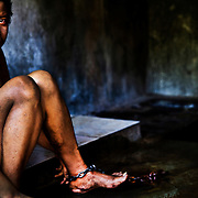 "Ketut, 32 years old..Schizophrenic for 5 years, in ""prison"" since 4. He lives naked, he doesn't want clothes, he rips them off as soon as his father tried to put them on him"
