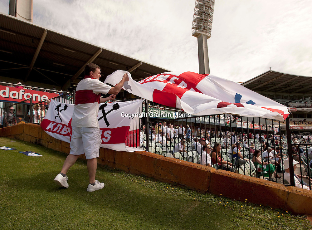 A visiting supporter wrestles with his flag in the breese during the third Ashes test match between Australia and England at the WACA (West Australian Cricket Association) ground in Perth, Australia. Photo: Graham Morris (Tel: +44(0)20 8969 4192 Email: sales@cricketpix.com) 17/12/10