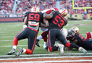 Arizona Cardinals running back David Johnson (31) tries to jump into the end zone as he gets stopped on the play by San Francisco 49ers inside linebacker NaVorro Bowman (53) and San Francisco 49ers outside linebacker Aaron Lynch (59) in the third quarter during the 2015 week 12 regular season NFL football game against the San Francisco 49ers on Sunday, Nov. 29, 2015 in Santa Clara, Calif. The Cardinals won the game 19-13. (©Paul Anthony Spinelli)