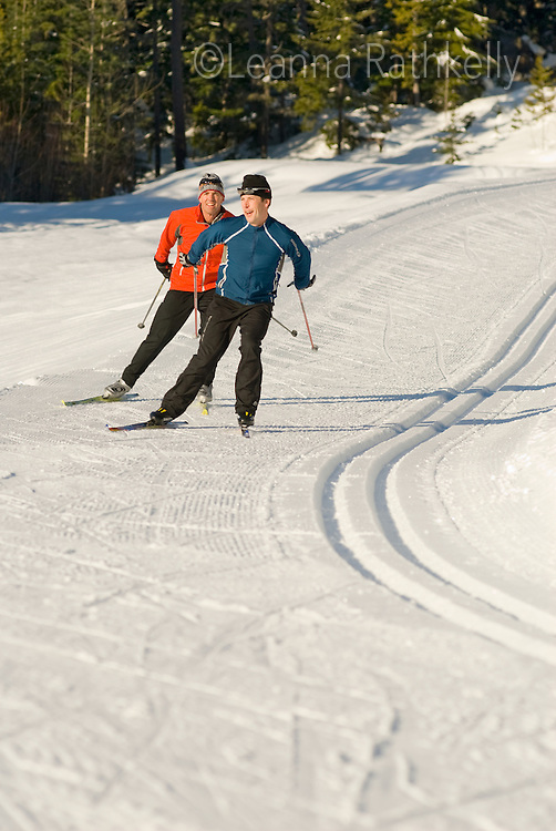 Cross country skiers Lee Harrison and Munro Duncan skate the trails on the Chateau, Lost Lake Trails, Whistler, BC