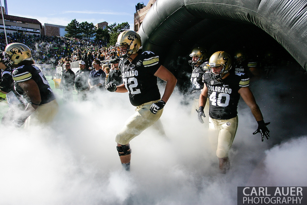October 5th, 2013:  The Colorado Buffaloes take the field prior to the start of action in the NCAA football game between the University of Oregon Ducks and the Colorado Buffaloes at Folsom Field in Boulder, Colorado