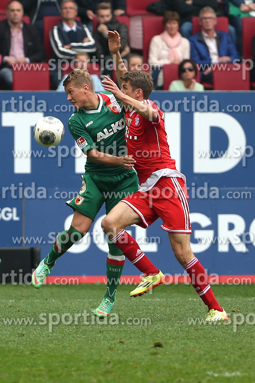05.04.2014, SGL Arena, Augsburg, GER, 1. FBL, FC Augsburg vs FC Bayern Muenchen, 29. Runde, im Bild Zweikampf zwischen Matthias Ostrzolek (# 19, FC Augsburg) und Thomas Mueller (# 25, Bayern Muenchen) // during the German Bundesliga 29th round match between FC Augsburg and FC Bayern Munich at the SGL Arena in Augsburg, Germany on 2014/04/05. EXPA Pictures &copy; 2014, PhotoCredit: EXPA/ Eibner-Pressefoto/ Fastl<br /> <br /> *****ATTENTION - OUT of GER*****