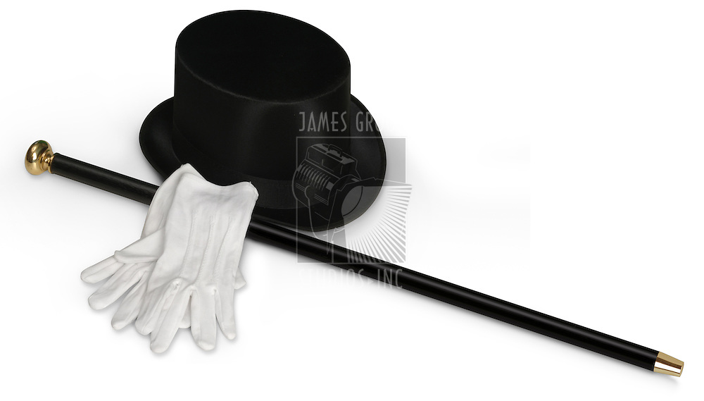 Top hat, white gloves and black cane isolated on white with clipping path