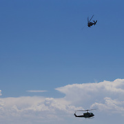 An HH-60 Blackhawk provides overwatch gunship coverage to a UH-1 Huey as the Huey hovers to pick up a simulated casualty during the 58th Special Operations Wing demo at the 2016 Kirtland Air Show