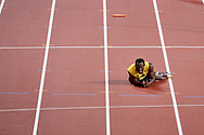 Great Britain, London - 2017 August 12: Usain Bolt of Jamaica reacts after falling to the track while men's 4x100m relay final during IAAF World Championships London 2017 Day 9 at London Stadium on August 12, 2017 in London, Great Britain.<br /> <br /> Mandatory credit:<br /> Photo by © Adam Nurkiewicz<br /> <br /> Adam Nurkiewicz declares that he has no rights to the image of people at the photographs of his authorship.<br /> <br /> Picture also available in RAW (NEF) or TIFF format on special request.<br /> <br /> Any editorial, commercial or promotional use requires written permission from the author of image.