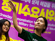 "SEOUL, SOUTH KOREA: Women do an interpretive dance during the Wednesday protest at the Japanese embassy in Seoul. The Wednesday protests have been taking place since January 1992. Protesters want the Japanese government to apologize for the forced sexual enslavement of up to 400,000 Asian women during World War II. The women, euphemistically called ""Comfort Women"" were drawn from territories Japan conquered during the war and many came from Korea, which was a Japanese colony in the years before and during the war. The ""comfort women"" issue is still a source of anger of many people in northeast Asian areas like South Korea, Manchuria and some parts of China.       PHOTO BY JACK KURTZ   <br /> Wednesday Demonstration demanding Japan to redress the Comfort Women problems"