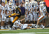 September 3, 2011: Iowa Hawkeyes wide receiver Marvin McNutt (7) stays in bounds after being hit by Tennessee Tech Golden Eagles cornerback Taylor Hennigan (10) during the first half of the game between the Tennessee Tech Golden Eagles and the Iowa Hawkeyes at Kinnick Stadium in Iowa City, Iowa on Saturday, September 3, 2011. Iowa defeated Tennessee Tech 34-7 in a game stopped at one point due to lightning and rain.