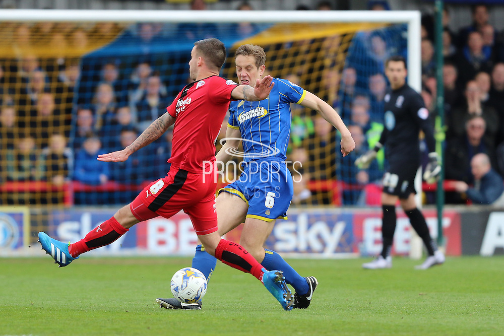 Paul Robinson defender for AFC Wimbledon (6) in action during the Sky Bet League 2 match between AFC Wimbledon and Crawley Town at the Cherry Red Records Stadium, Kingston, England on 16 April 2016. Photo by Stuart Butcher.