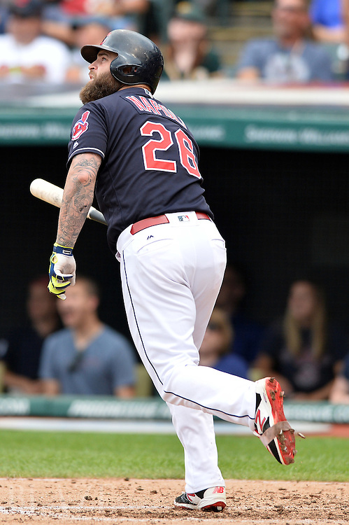 Jul 31, 2016; Cleveland, OH, USA; Cleveland Indians designated hitter Mike Napoli (26) watches his third inning home run against the Oakland Athletics at Progressive Field. Mandatory Credit: Ken Blaze-USA TODAY Sports