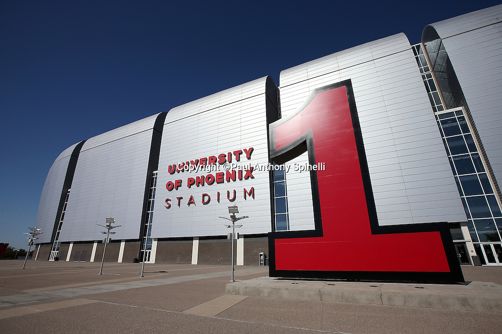 Gate number 1 stands tall in front of the University of Phoenix Stadium in this wide angle, general view photograph of the stadium exterior taken before the Arizona Cardinals 2015 NFL preseason football game against the San Diego Chargers on Saturday, Aug. 22, 2015 in Glendale, Ariz. The Chargers won the game 22-19. (©Paul Anthony Spinelli)