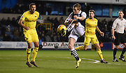 Shane Ferguson plays a dangerous ball back into the area during the Johnstone's Paint Trophy semi final first leg match between Millwall and Oxford United at The Den, London, England on 14 January 2016. Photo by Michael Hulf.