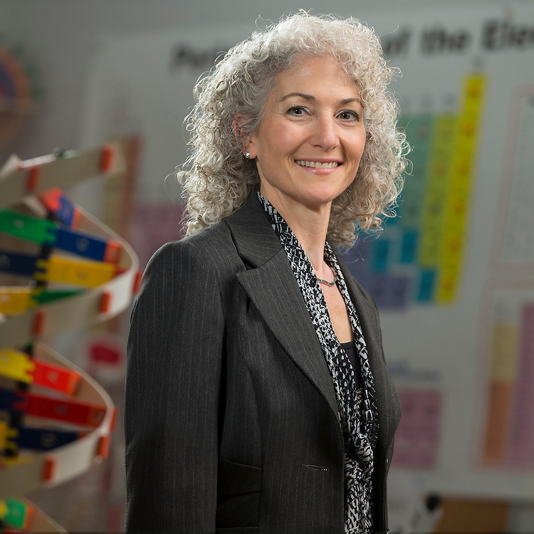 Bonnie Schmidt, founder of Let's Talk Science poses four a portrait in the science lab at St. Andre Bessette in London, Ontario.