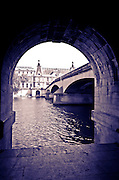 The Seine River through arch along the quay, Paris, France