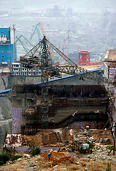 CHINA HUBEI PROVINCE THREE GORGES DAM MAY99 - A view on the construction site of the Three Gorges Dam. Seven large cities, including Chongquing, and thousands of villages will be submerged once the water level rises after the completion of the controversial Three Gorges Dam project further downriver. The flooding of areas reaching back more than 550Km upriver will require the evacuation and resettlement of more than 10 million people.  jre/Photo by Jiri Rezac. © Jiri Rezac 1999. . Contact: +44 (0) 7050 110 417. Mobile:  +44 (0) 7801 337 683. Office:  +44 (0) 20 8968 9635. . Email:   jiri@jirirezac.com. Web:     www.jirirezac.com