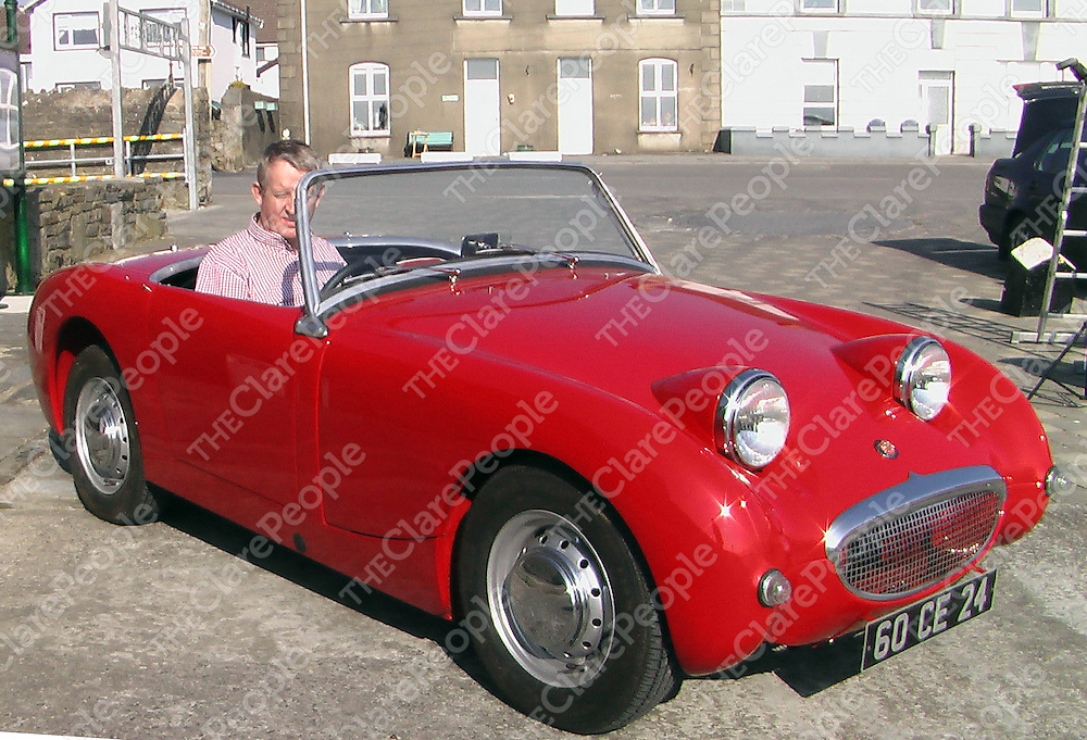 Billy Roche takes advantage of the spring sunshine at Cappa Pier, Kilrush to take a spin in his 1960 Austin Healy Frogege.<br /> Josephine Glynn