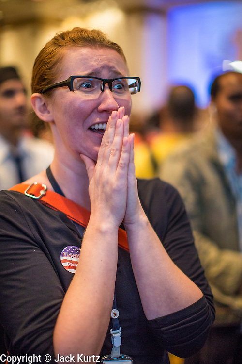 07 NOVEMBER 2012 - BANGKOK, THAILAND:  MARY CONGER, a US educator originally from Minnesota but now living in Thailand, reacts to election results as they're posted at the US Embassy's election watch party. She said she supported President Obama's reelection. US President Barack Obama won a second term Tuesday when he defeated Republican Mitt Romney. Preliminary tallies gave the President more than 300 electoral votes, well over the 270 needed to win. The election in the United States was closely watched in Thailand, which historically has very close ties with the United States. The American Embassy in Bangkok sponsored an election watching event which drew thousands to a downtown Bangkok hotel. American Democrats in Bangkok had their own election watch party at a restaurant in Bangkok.      PHOTO BY JACK KURTZ
