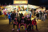 (Gabe Green | The Daily World)<br /> <br /> From left, Dillen Espana, 14, Enrique Ontiveris, 14, Alex Renteria, 14, and Caleb Lock, 14, hang out at the Grays Harbor County Fair Saturday evening.
