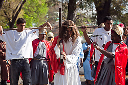 Hector L. Soliman portrays Jesus during the Stations of the Cross.  Jose Castillo portrays the soldier.