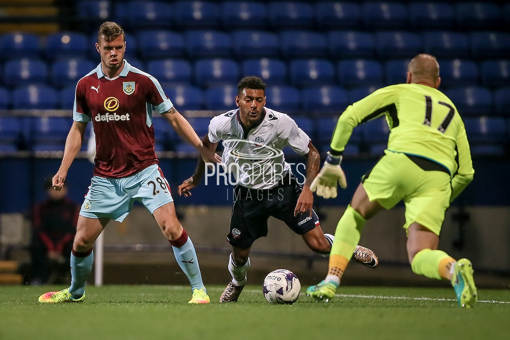 Kaiyne Woolery (Bolton Wanderers) tries to get to the ball, while Kevin Long (Burnley) blocks his run and Paul Robinson (Burnley) makes the save during the Pre-Season Friendly match between Bolton Wanderers and Burnley at the Macron Stadium, Bolton, England on 26 July 2016. Photo by Mark P Doherty.
