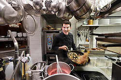 Peter Foltynowicz, head chef at Nada, in Cologne, Germany, preps for the evening dinner service. Photographed for The New York Times. (Photo © Jock Fistick)