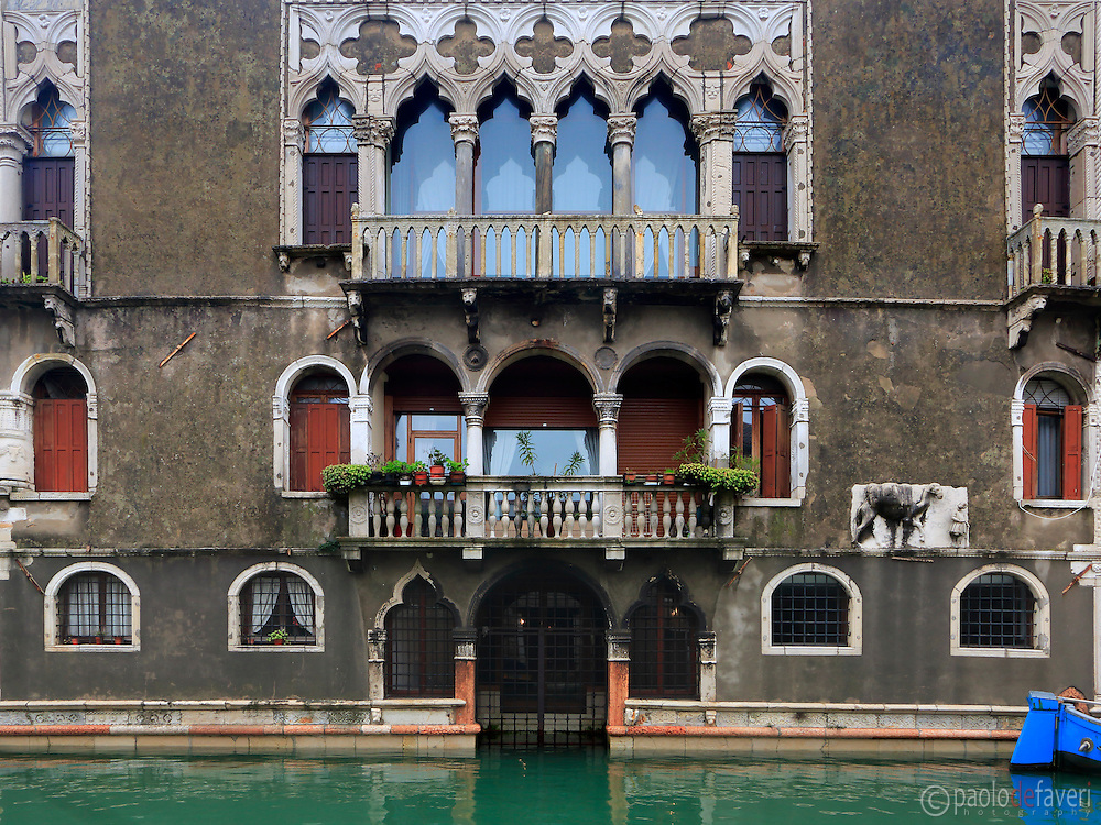 """The facade of Palazzo Mastelli, also knows as Palazzo del Cammello or, in venetian dialet """"caxa del Camelo (camel's house) is a building on the Rio Madonna dell'Orto, a canal in Venice, Italy"""