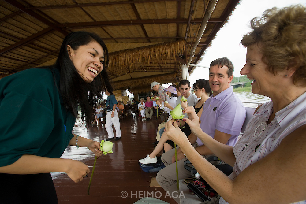 River Kwai cruise for E&O passengers. Flower folding lesson.