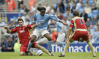 Photo: Aidan Ellis.<br /> Manchester City v Portsmouth. The Barclays Premiership.<br /> 27/08/2005.<br /> Manchester's Kiki Musampa is challenged by pompy's Richard Hughes