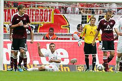 11.09.2011,  Rhein Energie Stadion, Koeln, GER, 1.FBL, 1. FC Koeln vs 1. FC Nürnberg, im Bild.Lukas Podolski (Koeln #10) entaeuscht / entäuscht / traurig zwischen Nürnbergern..// during the 1.FBL, 1. FC Koeln vs 1. FC Nürnberg on 2011/09/11, Rhein-Energie Stadion, Köln, Germany. EXPA Pictures © 2011, PhotoCredit: EXPA/ nph/  Mueller *** Local Caption ***       ****** out of GER / CRO  / BEL ******
