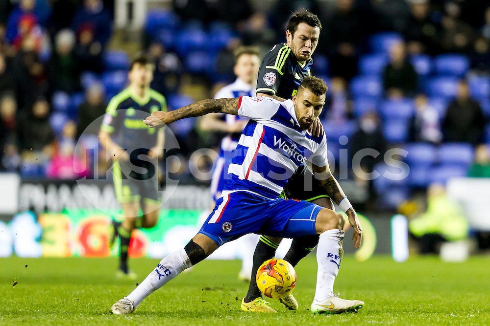 Lee Tomlin of Middlesbrough pressures Daniel Williams of Reading during the Sky Bet Championship match between Reading and Middlesbrough at the Madejski Stadium, Reading, England on 10 January 2015. Photo by Gareth  Brown.